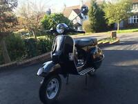 Great condition Vespa PX 125 Black, 5 months warranty left.