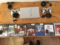 Silver PS2, two controllers, games, memory cards