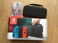 Nintendo Switch Console (Neon Red & Blue) with Super Mario Odyssey & Carry Case - AS NEW Condition