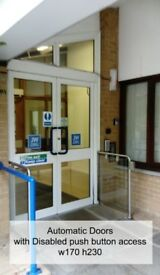 Automatic Doors with Disabled Access Buttons. White Aluminium Doors. Double Doors.