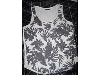 M & Co cream vest with dark grey floral patterns and sequins