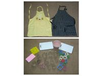 bundle of cook ware-cutters, aprons, bowl, chopping boards and silicone trays