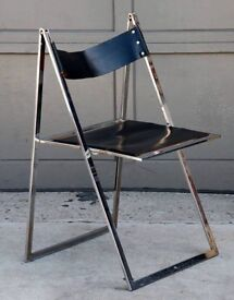 Minimalistic chrome and leather folding chair by designer Elios