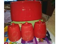 Red ceramic bread bin + 3 matching storage jars