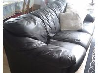 Black genuine leather 3 seater sofa - good condition - £100 (offers considered)