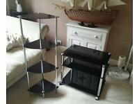 Black glass 2 tier table and matching shelf unit.