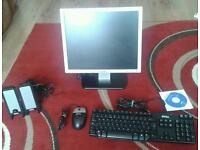 Dell 17 inch LCD monitor, keyboard, speakers and mouse