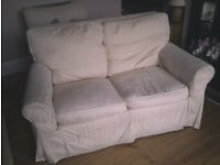 Free sofa and armchair, old and battered but usable, or for re-uphostery project.
