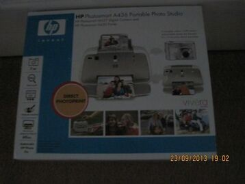 Digital Camera With Its Own Docking Printer. Hp Photosmart Complete With User Guide.