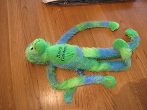 Busch-Gardens-theme-park-monkey-green-blue-hanging-long-arms-legs