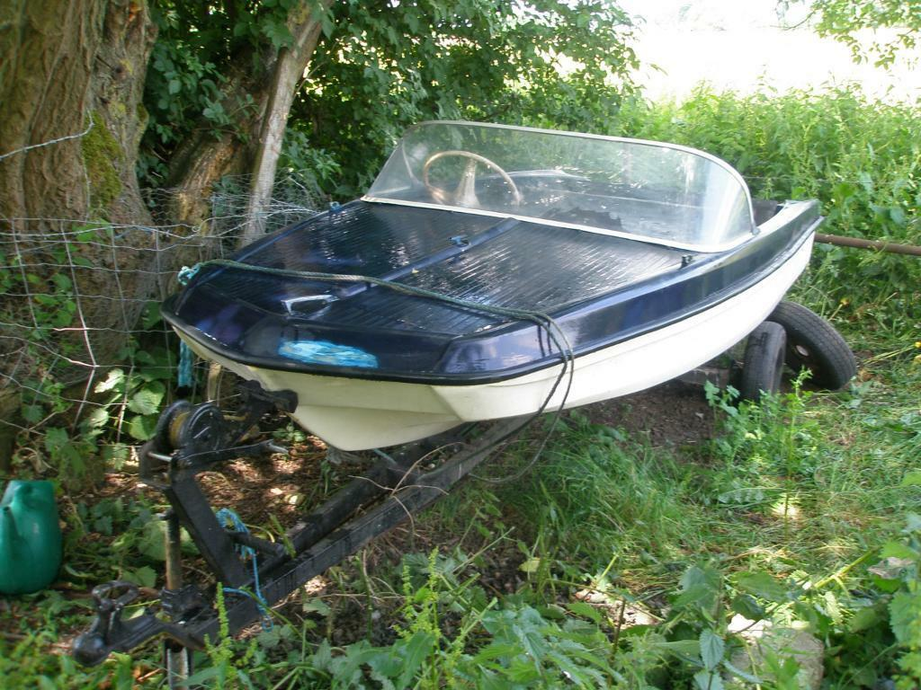 Vintage fibreglass fishing boat with trailer for sale
