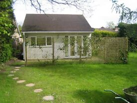Modern, furnished, detached,1 bed flat/studio/apt. in quiet location. Would suit professional.