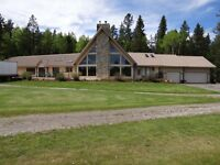 Excellent bungalow on 26 acre parcel, Cochrane, Alberta