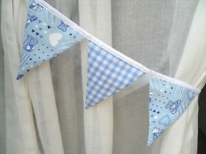 Pair of baby blue nursery fabric bunting curtain tie backs for Curtain fabric for baby nursery