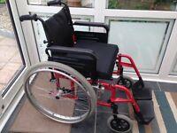 Folding wheelchair.