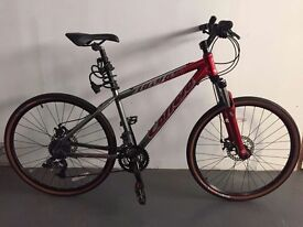 Carrera Kraken women's bike in great condition. Red and silver.
