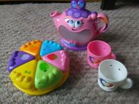 Children's Leap Frog Teapot. 2 teacups a sharing cake on plate. Pretend play making tea
