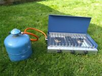 Camping stove and grill with half full gas bottle