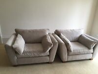 Two Next snuggle chairs in a silver grey chenille material. Very good condition.