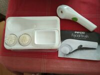 Pifco portable machine with 2 brushes for facial skin care.