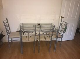 4 Chairs and Glass Dining Table