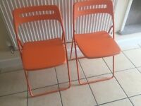 4 x Nisse Folding Dining Chairs in Orange from IKEA