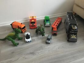 Set of toys. Cars and dinosaurs