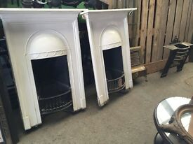 Pair of matching cast iron Victorian fire places.