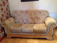 Two 3-Seater Beige Floral Fabric Sofas + 2 Matching Stools + 4 Matching Cushions