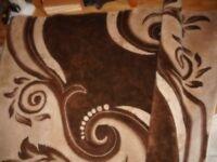 brown and cream swirl rug