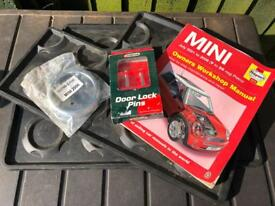 BMW Mini Haynes Manual, genuine rear mats and chrome bits.