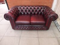 A Thomas Lloyd Oxblood Red Leather Chesterfield Two Seater Sofa