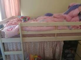 Pink child's bed with mattress