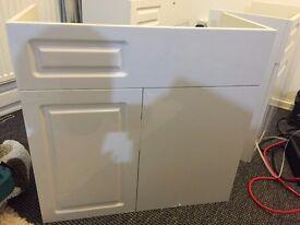 Brand new high gloss white floor standing 700x325mm sink corner vanity unit with offset door