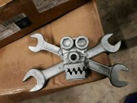 Skull and crossbones spanner art