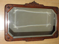 early 19th century antique and carved oak and bevelled glass wall mirror