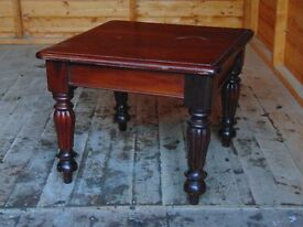 Carved mahogany coffee table