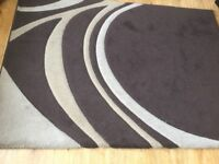 Brown swirl Dunelm rug size 91in-64in