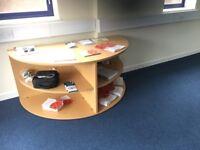 Semi circular storage unit with shelves in light oak