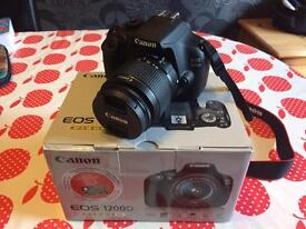 Canon EOS 1200D Digital SLR camera with EF-S 18-55mm f/3.5-5.6mm III Lens
