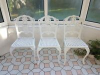 Three white metal conservatory/garden chairs