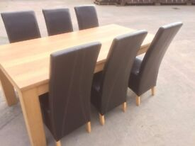 SOLID OAK DINING TABLE AND SIX LEATHER HIGH BACK CHAIRS