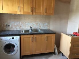 Kitchen with beech carcass and birch doors good used condition 8 units including sink and tap