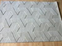 Brand new 100% cream wool rug size 169 cm long 119 cm width