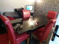 Black glass table & 4 red leather chairs