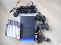 PS2 with parts and Sing Star mics and games