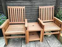 Two wood garden chairs 1 table good condition