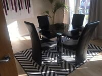 Modern dinning table and 4 chairs