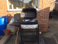 Gas BBQ with side Hob. Excelent condition, used 2/3 times comes with drip tray and utensils.