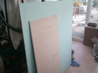 approximately half a sheet of treated wall plaster board